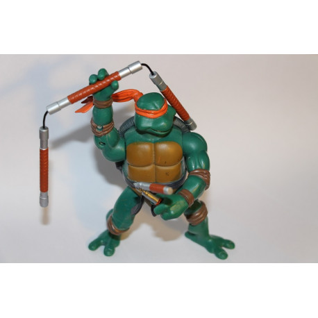 Combat Warriors Mike 2005 - TMNT figure (Including: Three-Section Staff & Trusty Nunchaku)