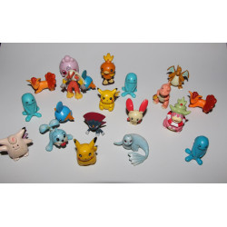 20 Original Pokemon figures with a lot of wear